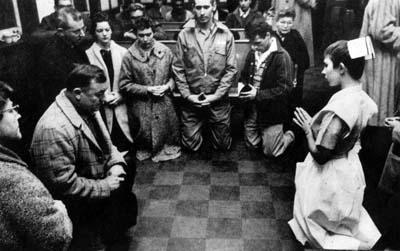 Father Larry Biskner praying
